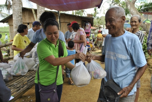 Farmers receive food packs during CARRD relief operations post-Typhoon Haiyan/Yolanda